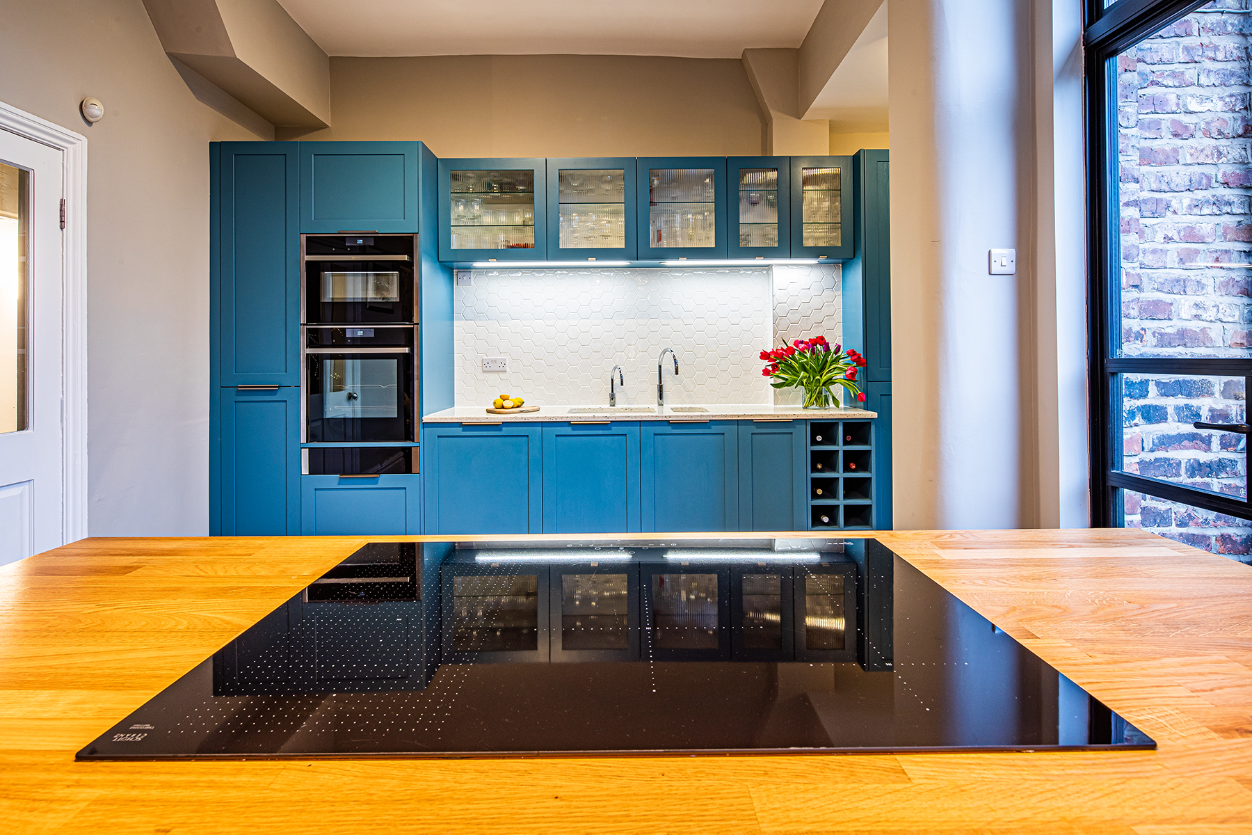 Manchester sustainable living kitchen with blue shaker doors and oak and recycled glass worktops