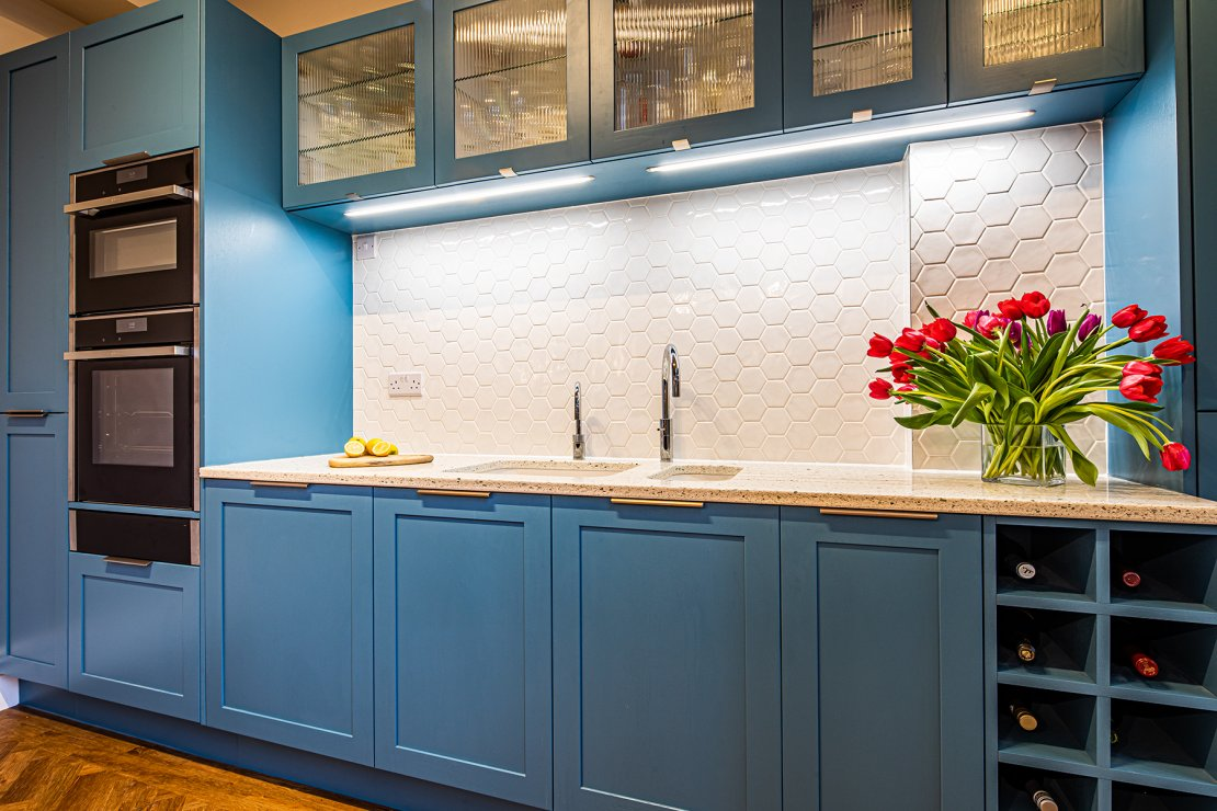 Manchester sustainable living kitchen with blue shaker doors and recycled glass worktops