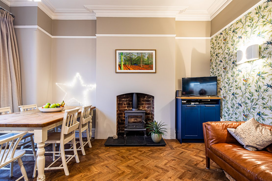 Manchester sustainable living kitchen with woodburner