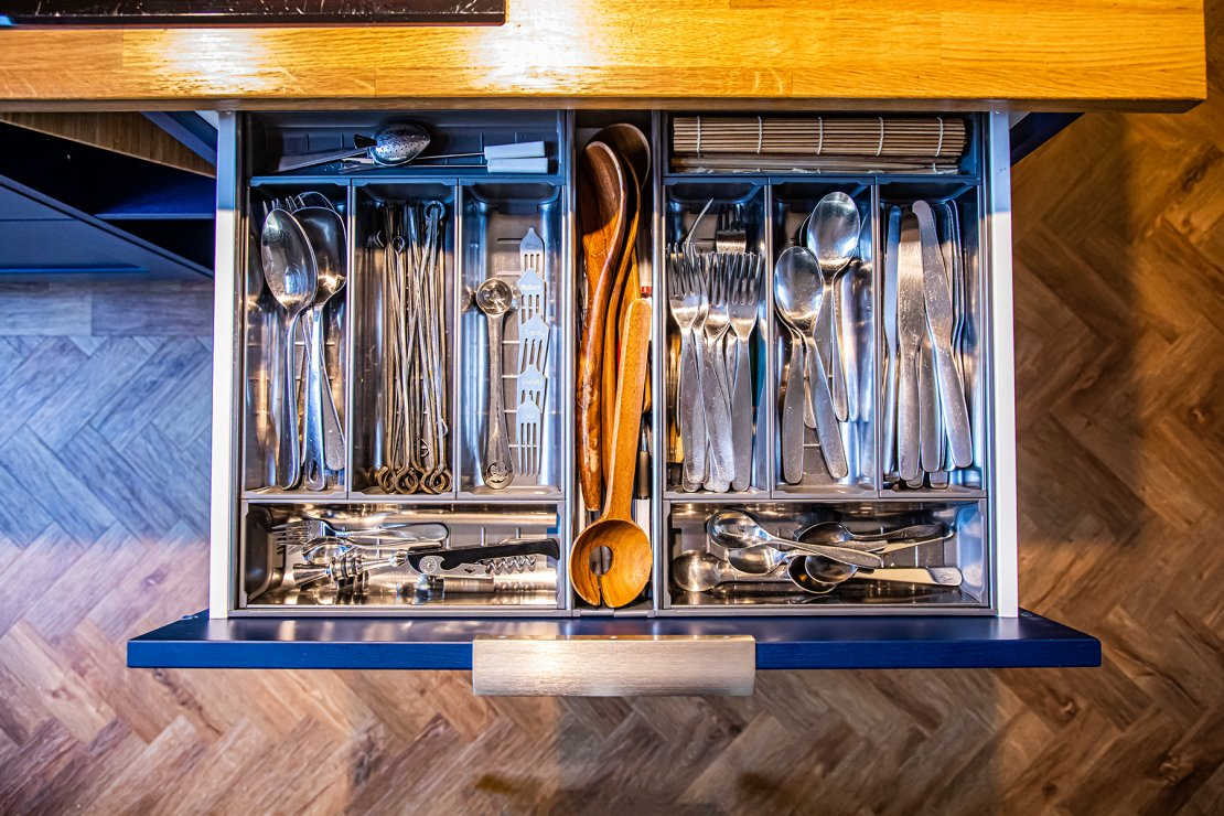 Manchester sustainable kitchen with blue cutlery drawer front and oak worktop