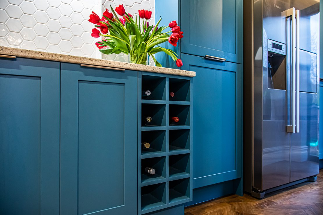 Manchester sustainable kitchen with blue shaker doors and wine rack