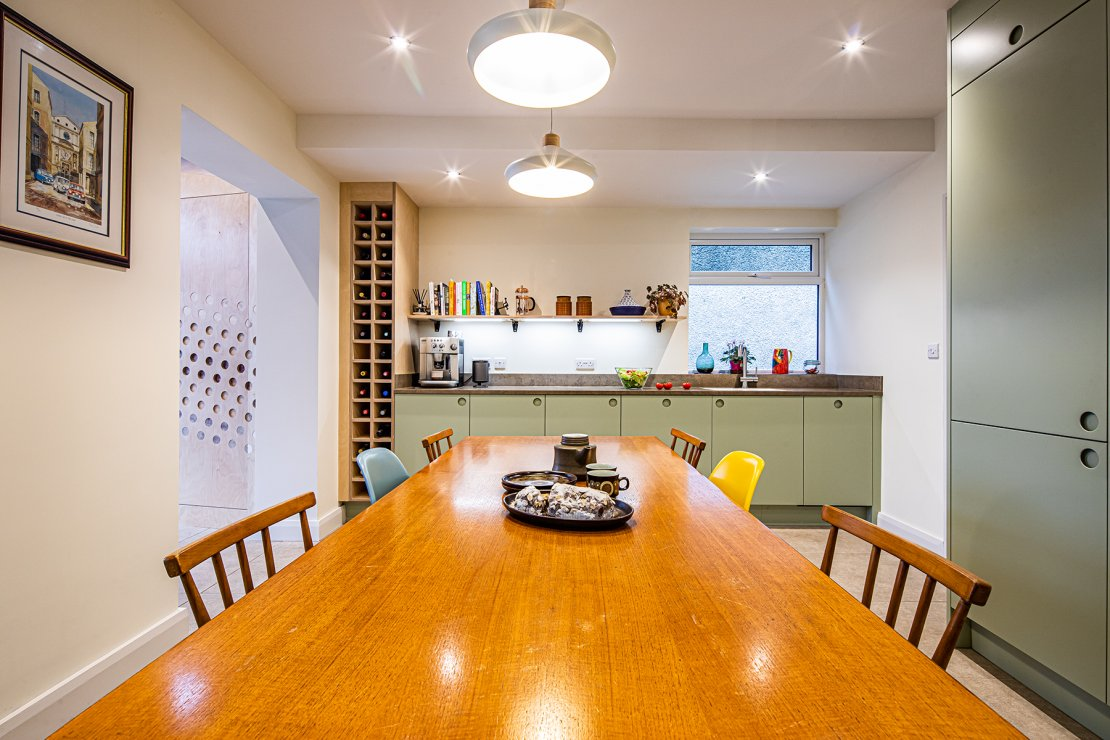 kitchen with dining table and bespoke wine storage
