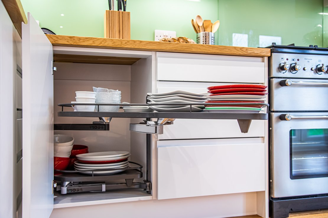 kitchen corner pull out displaying pots and pans