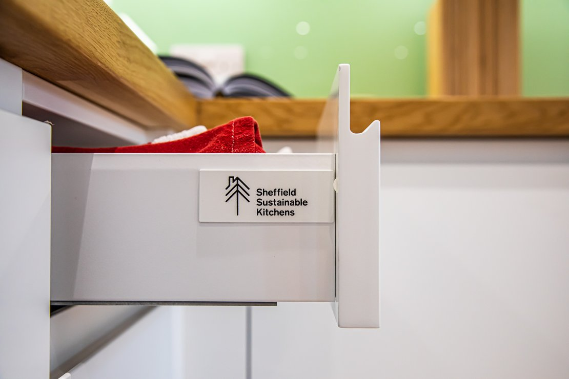 sheffield sustainable kitchens logo on the side of new kitchen drawer of