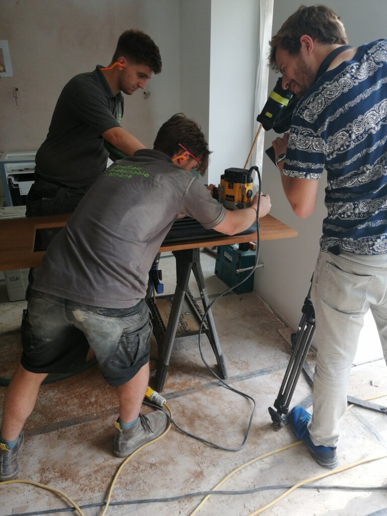 Two kitchen fitters being filmed for ugly house to lovely house