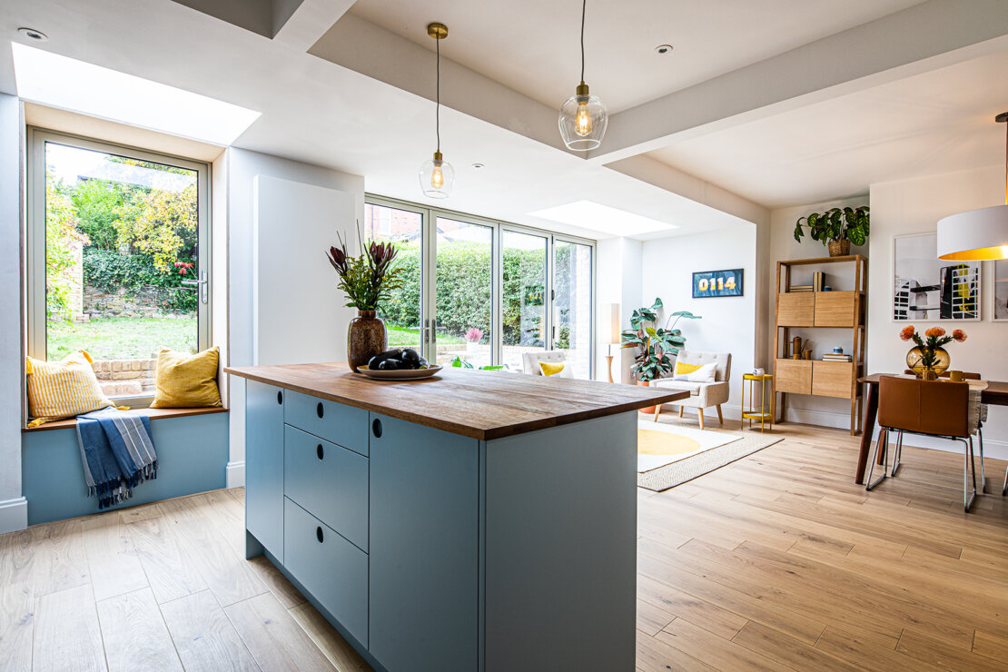 Blue kitchen island with bespoke cut out handles