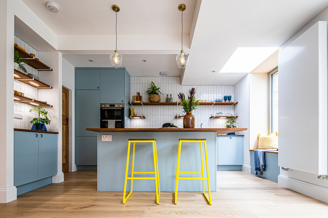 blue kitchen island with yellow stools ugly house to lovely house