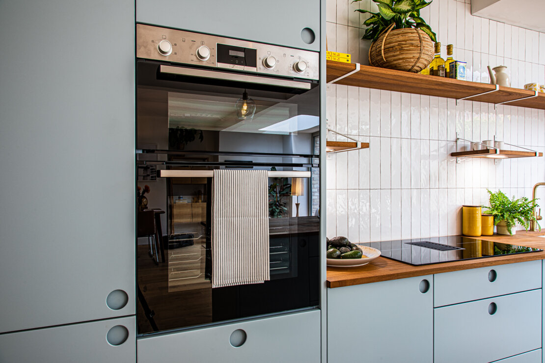 Bosch slide and hide double oven in bespoke kitchen unit