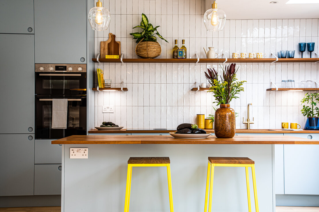 blue kitchen with reclaimed iroko and plants