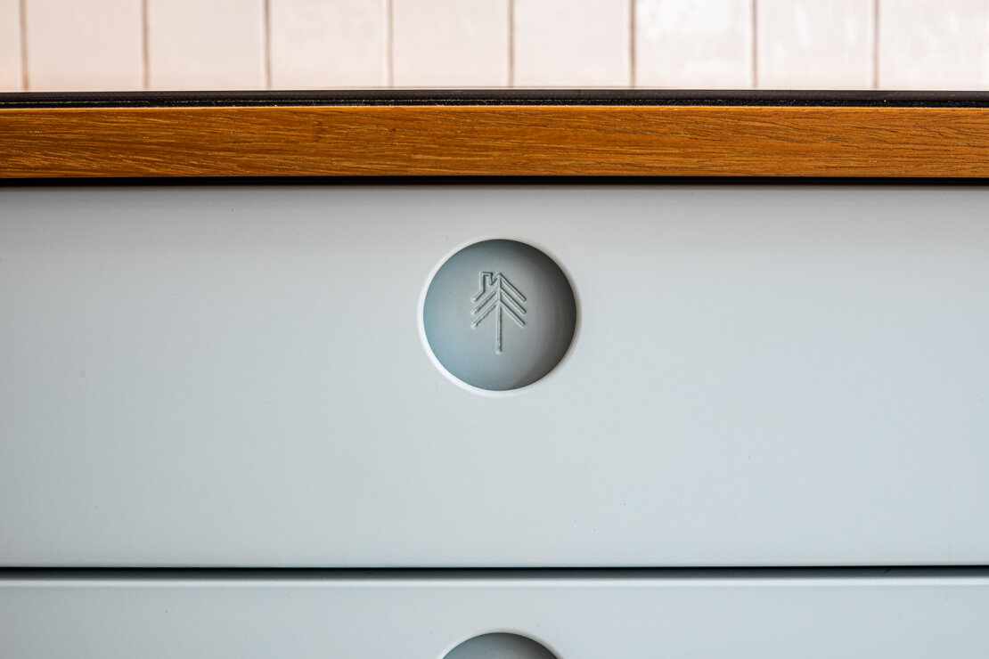 sheffield sustainable kitches logo inside cut out handle on kitchen drawer