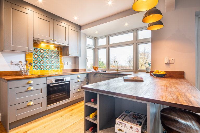 bespoke grey kitchen with brass and golden finishes