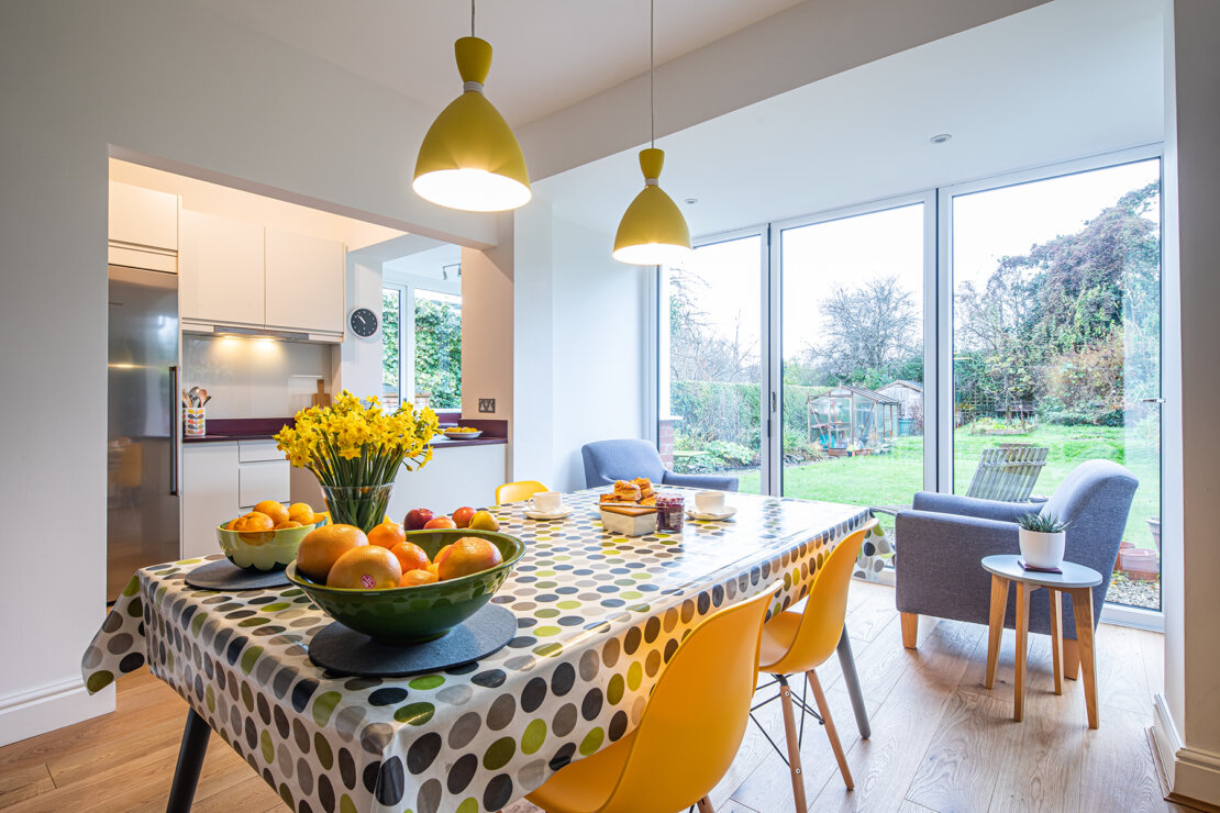 dining area to garden with colour