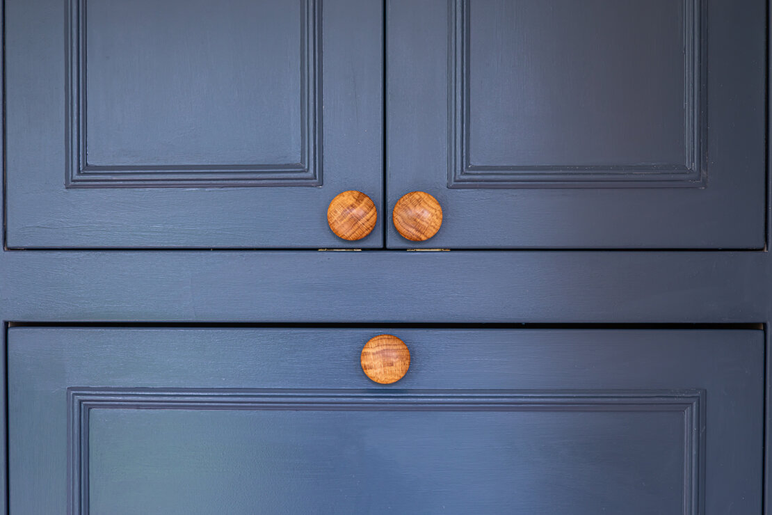 painted blue doors with knob handles