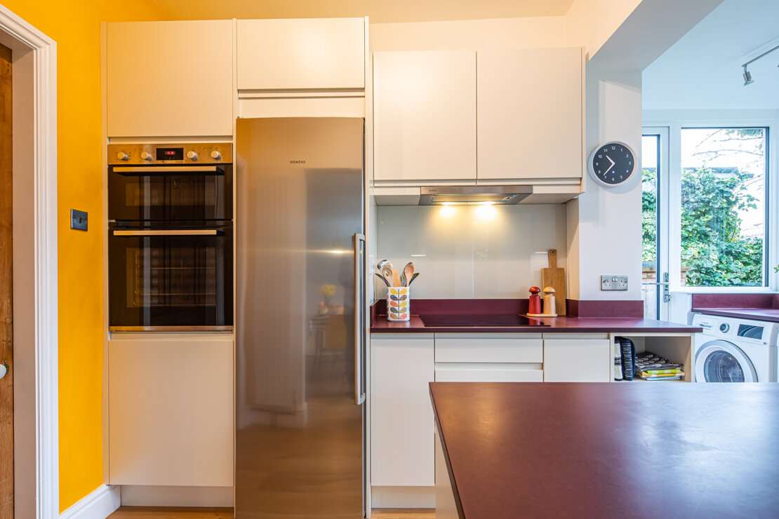 white compact kitchen with recycled paper worktop
