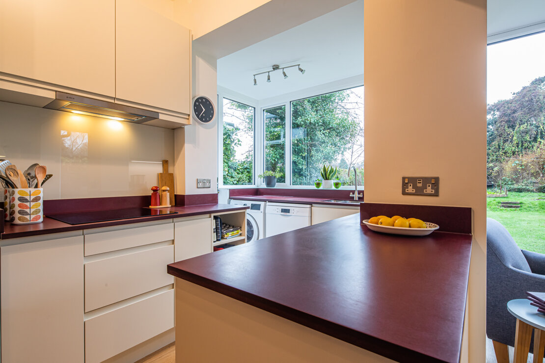 white kitchen with recycled paper worktop